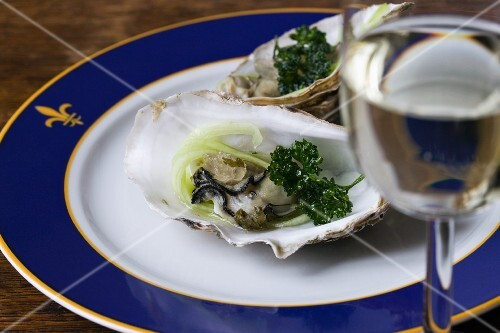 Poached oysters with cucumber strips