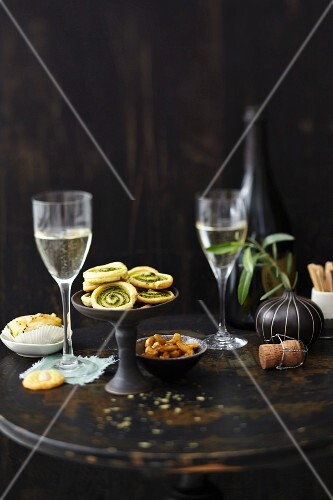 Various snacks and champagne on a table