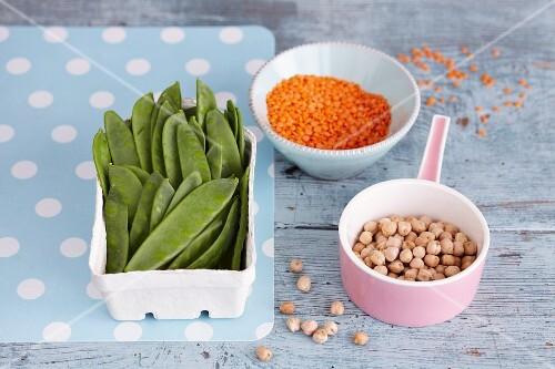 An arrangement of legumes: mange tout, lentils and chickpeas