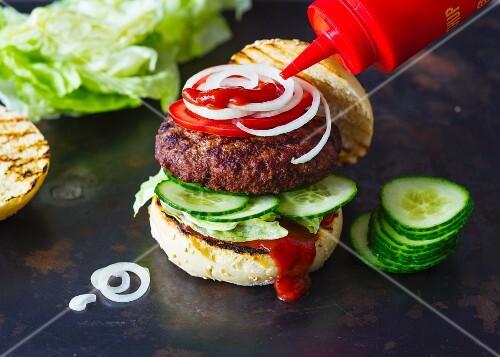 A hamburger with ketchup