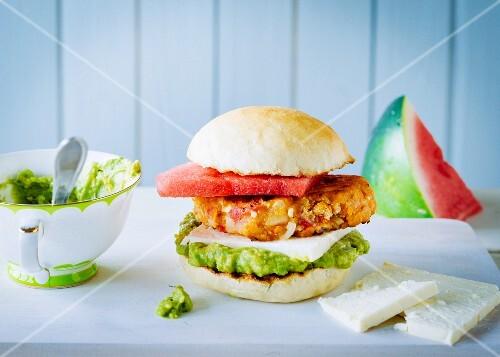 A summer lentil burger with guacamole, feta cheese and melon