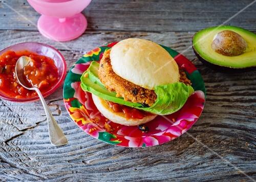 A vegan Mexican Burger: burger with tofu and salsa sauce