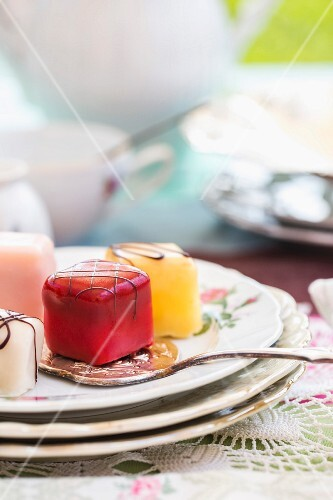 Various petit fours on a cake plate