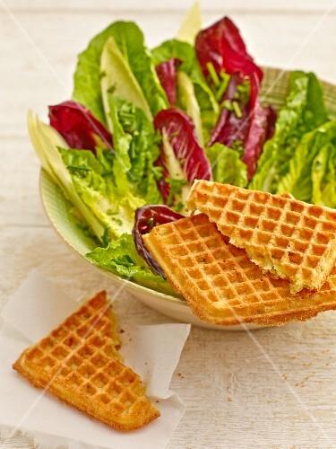 Potato waffles with a mixed leaf salad