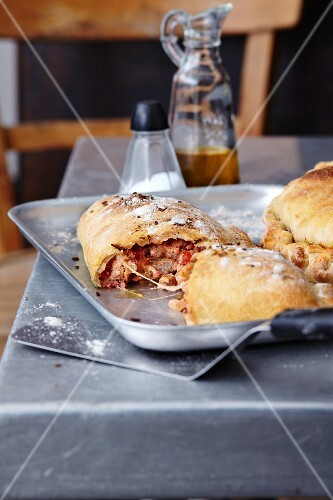 Calzone on a baking tray