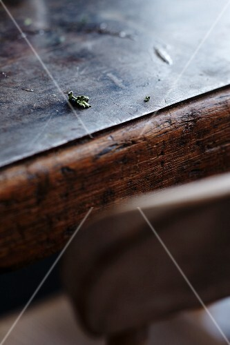 The remains of food and the edge of a plate on a wooden table