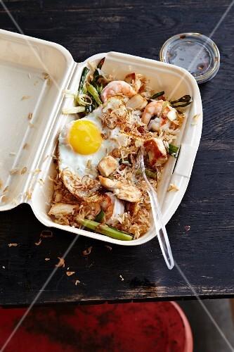 Nasi Goreng in a plastic takeaway box