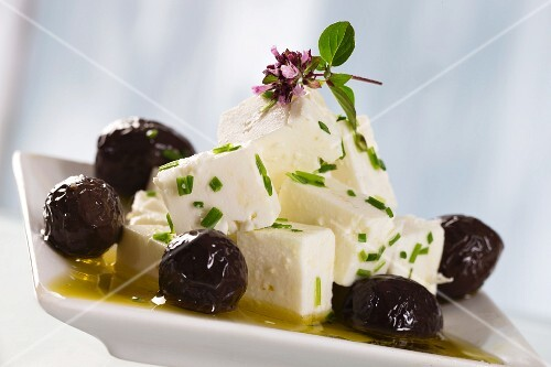 A salad of feta cheese, black olives, olive oil and oregano