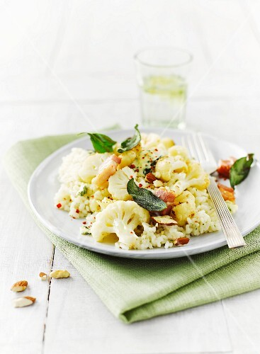 Almond risotto with cauliflower, sage, diced bacon and blue cheese served with lime water
