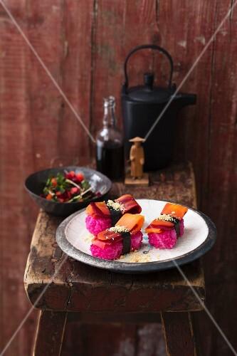 Vegetarian nigiri sushi with pink rice