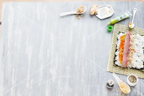 An arrangement of sushi featuring unfinished maki sushi