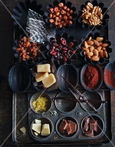 Various baking ingredients: spices, chocolate, nuts and dried fruits