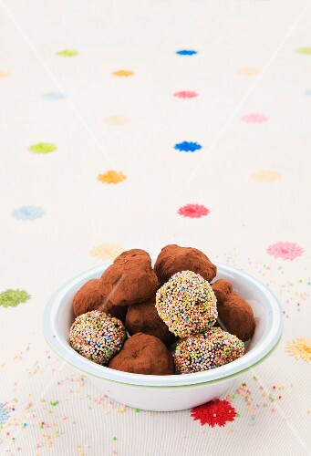 Chocolate truffles dusted with cocoa powder and sugar sprinkles
