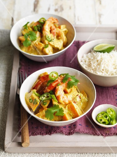 Spicy butternut squash curry with prawns, coconut milk, chilli peppers and rice (Asia)
