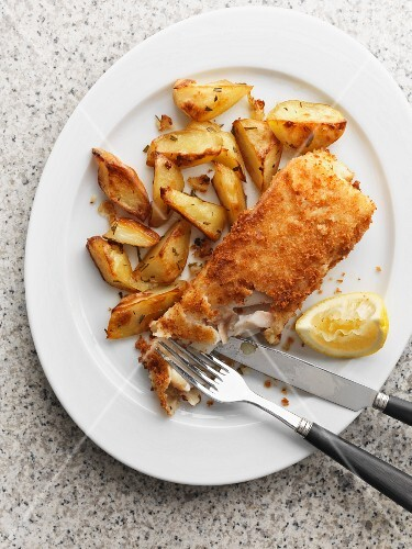 Fish and chips with a lemon wedge