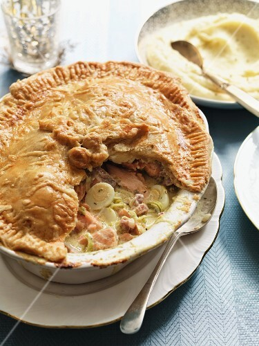 Salmon pie with bacon, quail's eggs and leek served with mashed potatoes (England)