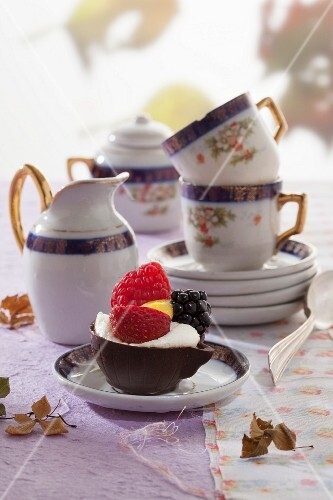 Chocolate cups with whipped cream and berries