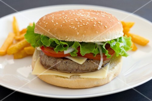 A cheeseburger with tomatoes and lettuce