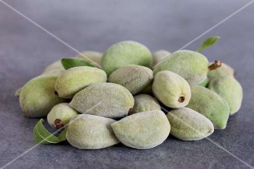 A pile of whole fresh almonds