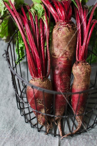 Three beetroots in a wire basket