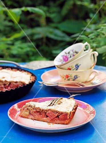 Rhubarb cake on a garden table