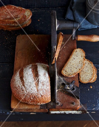 Wholemeal quark bread on an antique bread cutting machine