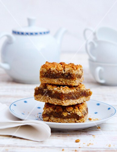 A stack of date crumble slices