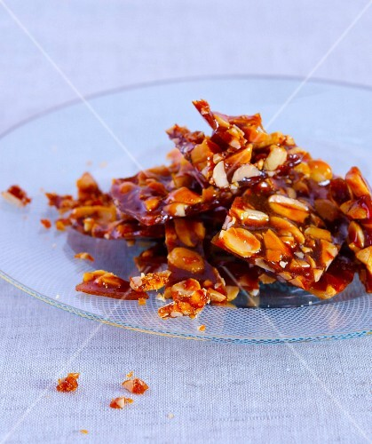 Peanut brittle on a glass plate