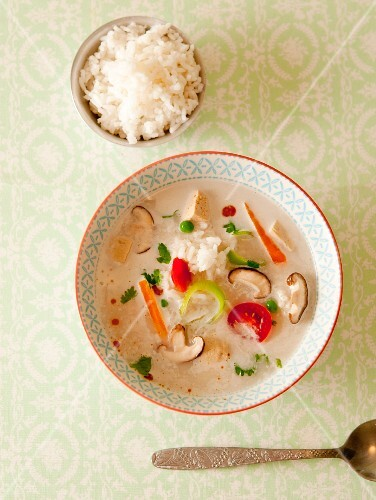 Coconut soup with mushrooms, vegetables and scented rice (Asia)