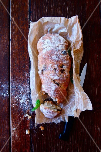 Ciabatta with olives on parchment paper