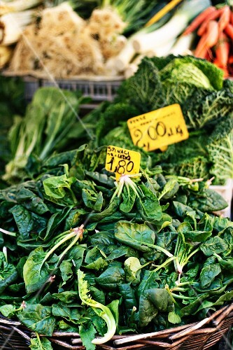 A basket of spinach at a market