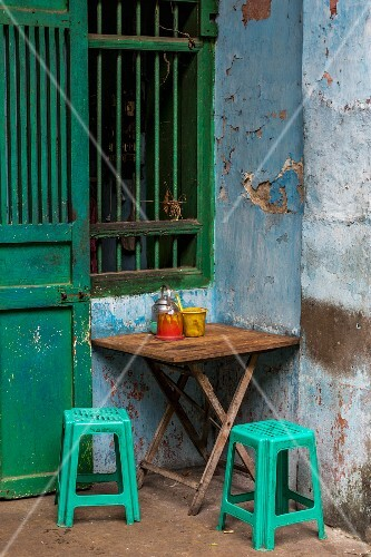A table and chairs in front of a tea shop in Yangon, Myanmar