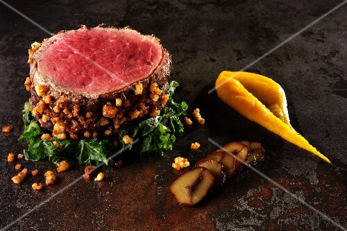Beef fillet with nuts and green kale