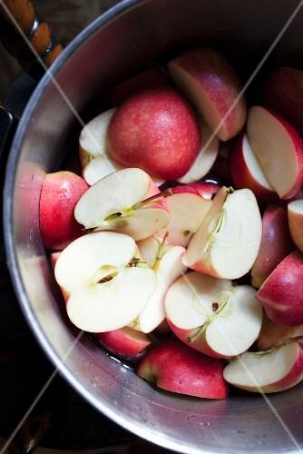 Halved apples in a metal bowl