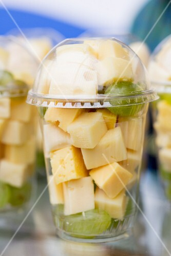 Cheese cubes and grapes in plastic pots to takeaway