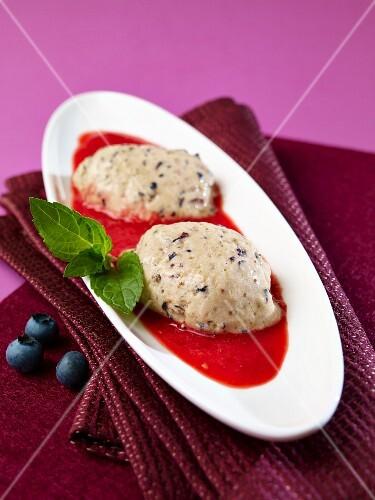 Blueberry and yogurt jelly with raspberry sauce