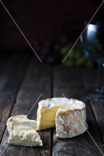 Soft cheese on a wooden surface
