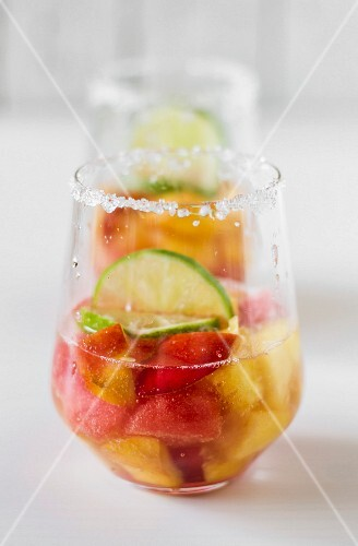 Fruit punch in a glass with a sugared rim