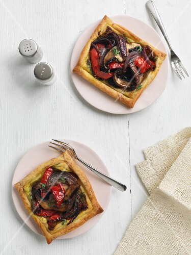 Puff pastry tarts with mushrooms, peppers and onions