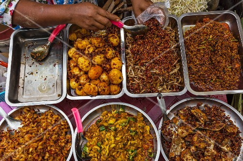 Various different curries at a food stall in Yangon, Myanmar