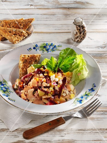 Vegetarian herring salad with smoked tofu and potatoes