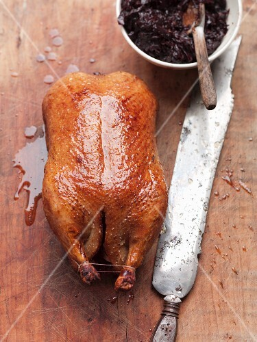 A whole roast duck with red cabbage