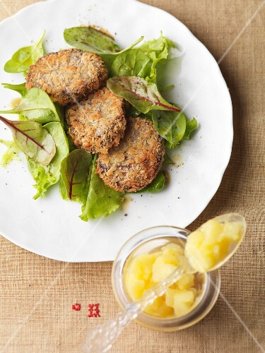 Breaded black pudding with lettuce and apple sauce