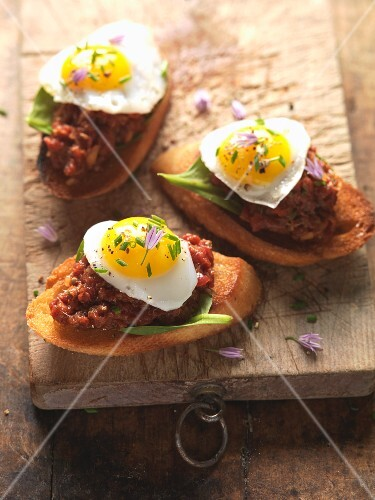 Dripping crostini with fried egg