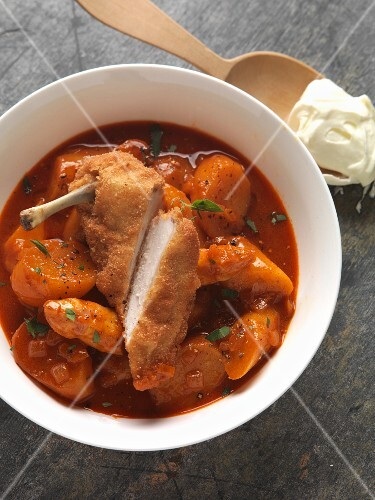 Potato and asparagus goulash with roast chicken