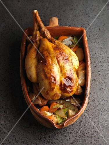 Roast chicken in a terracotta pot
