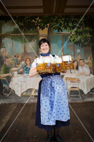 A waitress in a a Hofbräu festival tent at Oktoberfest, Munich