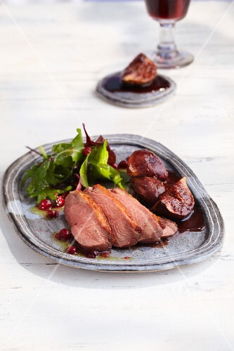 Duck breast on port wine figs and a salad with cranberry vinaigrette