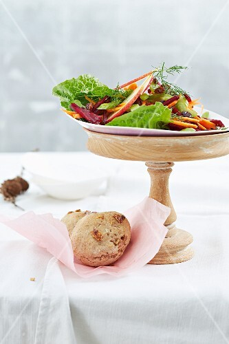 A winter Christmas salad with a spelt and walnut bread roll
