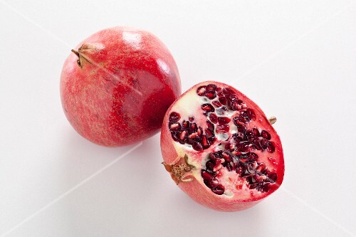 Pomegranate, whole and halved